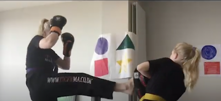 Two students are seen starting Martial Arts at Home