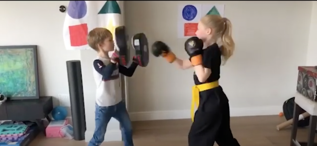 Two kids are seen starting Martial Arts at Home